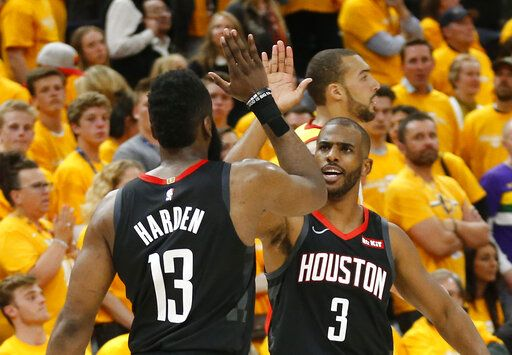 Houston Rockets' Chris Paul (3) and James Harden (13) celebrate after their NBA basketball game against the Utah Jazz Saturday, April 20, 2019, in Salt Lake City.