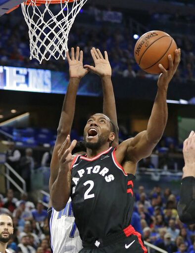 Toronto Raptors' Kawhi Leonard (2) makes a shot in front of Orlando Magic's Jonathan Isaac during the first half in Game 4 of a first-round NBA basketball playoff series, Sunday, April 21, 2019, in Orlando, Fla.