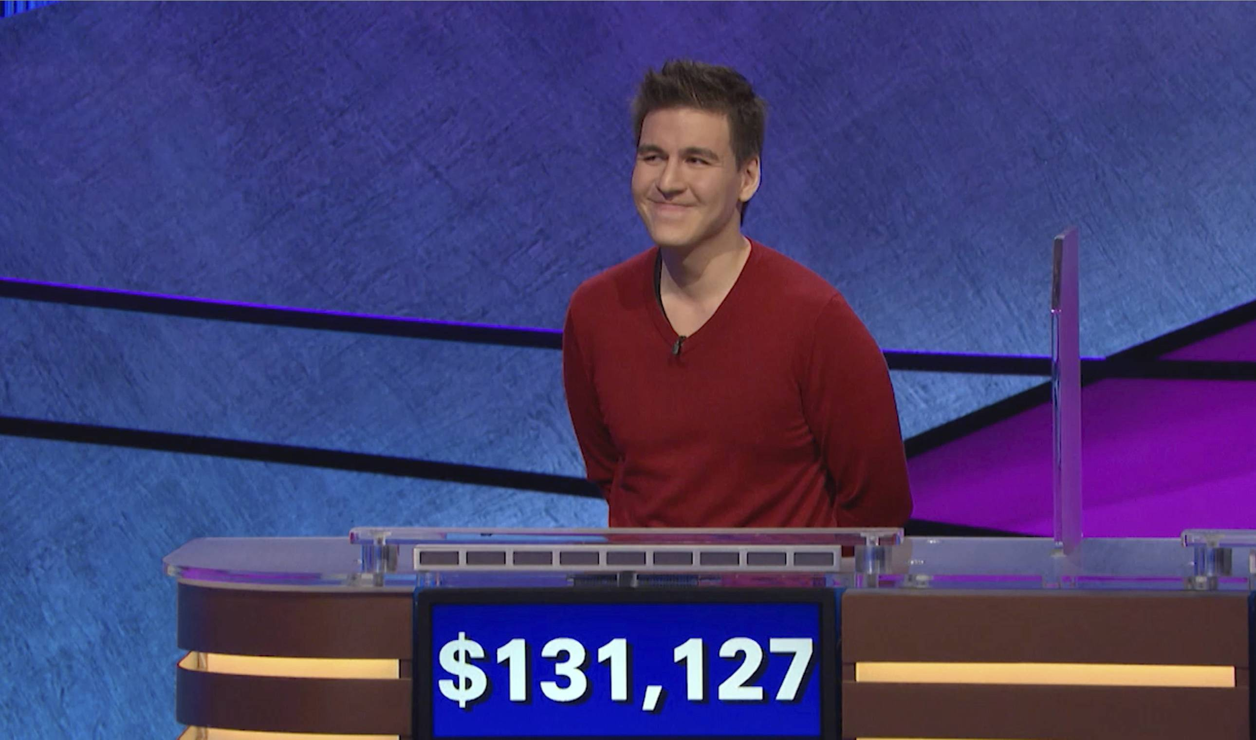 "This image made from video aired on ""Jeopardy!"" on Wednesday, and provided by Jeopardy Productions, Inc., shows James Holzhauer. A professional sports gambler who grew up in Naperville, Holzhauer won $131,127 during a show that aired Wednesday night, breaking the record that viewers saw him set last week."