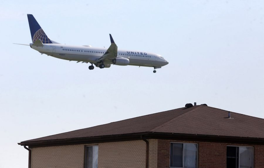 A United plane over apartments near Allstate Arena in Rosemont.
