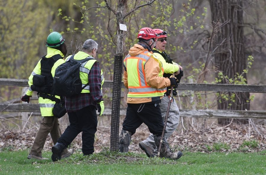 "Search and rescue personnel concentrate efforts Tuesday morning at Veteran Acres Park in Crystal Lake as police officials continue their investigation into the missing boy, Andrew ""AJ"" Freund."