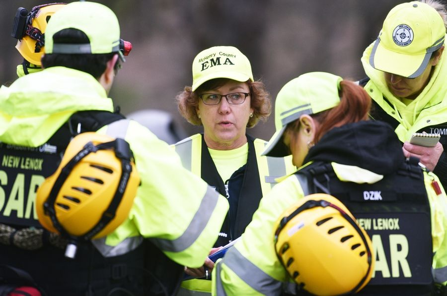 Pamela Kampwerth with McHenry County Emergency Management Agency gives instructions to a group of New Lenox search and rescue personnel Tuesday morning in Veteran Acres Park in Crystal Lake.