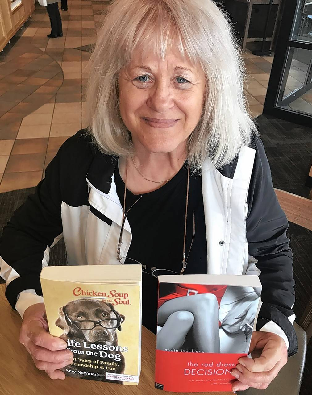 "Whether you're talking d-o-g or G-o-d, Bulgarian immigrant and Hanover Park resident Nadia Ianakieva can tell a passionate story. Her book, ""The Red Dress Decision,"" features ""stories of a life filled with God's miracles,"" and an essay about her dog, Oso, is included in ""Life Lessons from the Dog."""