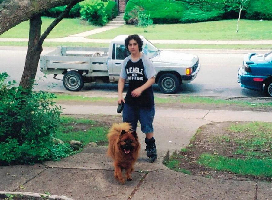 "In the new book, ""Life Lessons from the Dog,"" Hanover Park writer Nadia Ianakieva explains how her dog Oso, shown here with her son Andon, saved her life."