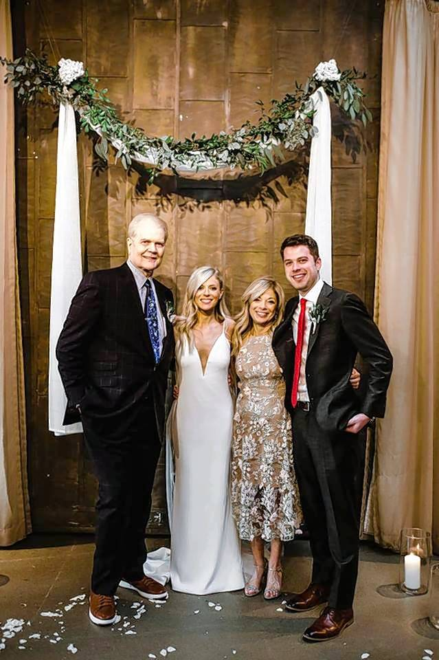 "Lyndsey Coppock at her March wedding with her father, Chet, mother Anna Busalacchi, and brother, Tyler Coppock. ""He was so happy that day,"" Tyler said of his Dad on his sister's wedding day."