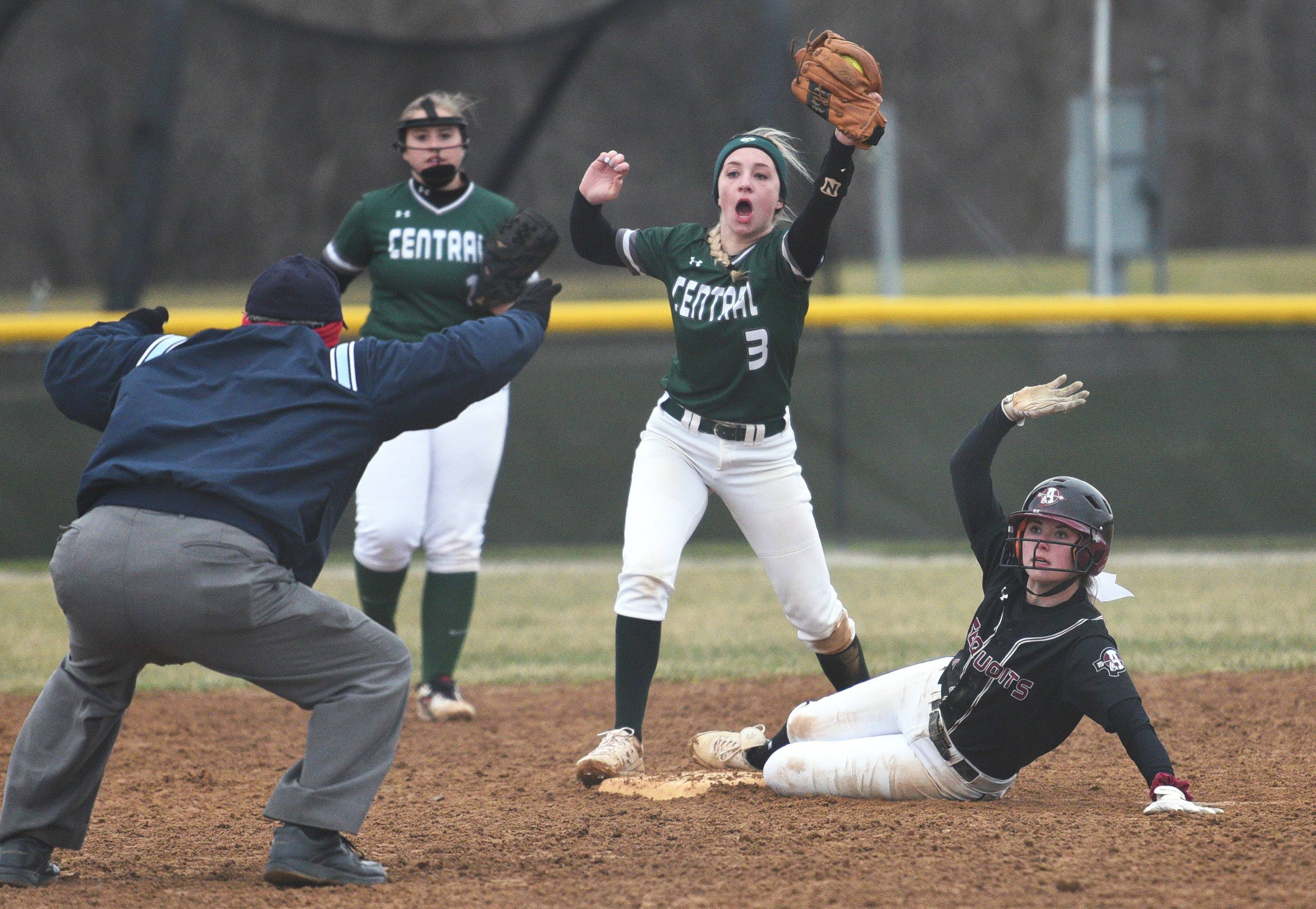 Antioch's Abby Pyburn, right, is called safe at second base by the umpire despite Grayslake Central's Kennedy Stoffel (3) showing him the ball after laying down the tag during Thursday's softball game in Antioch.
