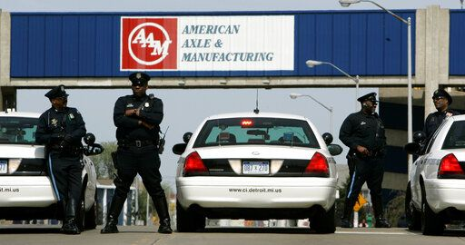 FILE - In this April 24, 2008, file photo, Detroit police officers block an entrance to the American Axle and Manufacturing Holdings plant in Detroit. Google's self-driving car spinoff Waymo says it will reopen an axle plant in Detroit to convert conventional vehicles so they can drive autonomously. The company says it will lease a now-closed American Axle & Manufacturing plant north of downtown so it can convert the vehicles, mostly Chrysler Pacifica minivans.