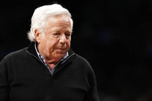 FILE - In this April 10, 2019, file photo, New England Patriots owner Robert Kraft leaves his seat during an NBA basketball game between the Brooklyn Nets and the Miami Heat, in New York. Attorneys for two Florida massage parlor employees plan to ask a judge to hold police and prosecutors responsible for the possible unauthorized release of video that they say shows New England Patriots owner Robert Kraft paying for sex.