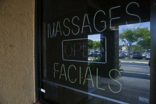 In this March 26, 2019 photo, shows the front entrance of the Orchids of Asia Day Spa in Jupiter, Fla. Attorneys for two Florida massage parlor employees plan to ask a judge to hold police and prosecutors responsible for the possible unauthorized release of video that they say shows New England Patriots owner Robert Kraft paying for sex.