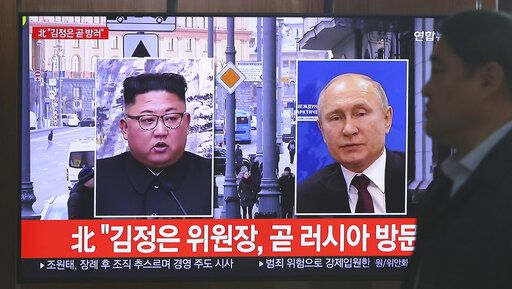 "A man passes by a TV screen showing images of North Korean leader Kim Jong Un, left, and Russian President Vladimir Putin, right, during a news program at the Seoul Railway Station in Seoul, South Korea, Tuesday, April 23, 2019. North Korea confirmed Tuesday that Kim will soon visit Russia to meet with Putin in a summit that comes at a crucial moment for tenuous diplomacy meant to rid the North of its nuclear arsenal. The screen reads: ""Kim Jong Un visits Russia soon."""