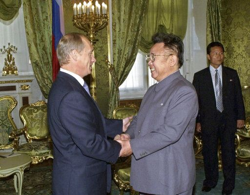 FILE In this Saturday, Aug. 4, 2001 file photo, Russian President Vladimir Putin, left, shakes hands with North Korean leader Kim Jong Il, during their meeting in Moscow, Russia. North Korean leader Kim Jong Un's summit with Russian President Vladimir Putin this week expands a diplomatic charm offensive that has included meetings with leaders from China, South Korea and the United States. (Sergei Velichkin/TASS/Sputnik Kremlin via AP, File)