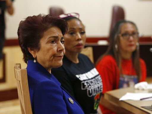 State Sen. Anna Caballero, D-Salinas, left, listens as members of the Senate Public Safety Committee discusses her police-backed law enforcement training bill during a hearing at the Capitol Tuesday, April 23, 2019, in Sacramento, Calif. Lawmakers worked to find common ground between law enforcement organizations, which support Caballero's bill and reformers supporting a competing measure, by Democratic Assemblywoman Shirley Weber, that would adopt the first-in-the-nation standards designed to limit fatal shootings by police.
