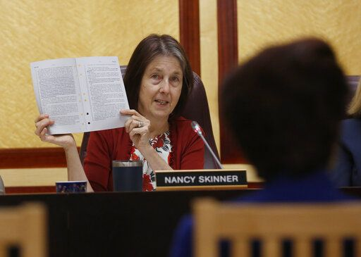 State Sen. Nancy Skinner, D-Berkeley, chairwoman of the Senate public safety committee, displays a copy of Democratic state Sen. Anna Caballero's police-backed law enforcement training bill during a hearing at the Capitol Tuesday, April 23, 2019, in Sacramento, Calif. Lawmakers worked to find common ground between law enforcement organizations, which support Caballero's bill and reformers supporting a competing measure, by Democratic Assemblywoman Shirley Weber, that would adopt the first-in-the-nation standards designed to limit fatal shootings by police.