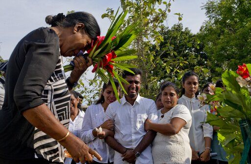 Nilanga Anthony, center, mourns the death of his seven-years old nephew Dhulodh Anthony, a victim of Easter Sunday bomb blast during the burial at Methodist cemetery in Negombo, Sri Lanka, Tuesday, April 23, 2019.