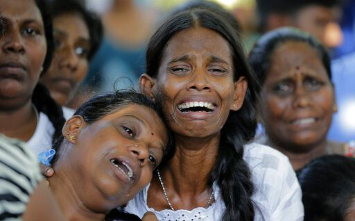 Relatives of the Burlington family weep during the funeral of their family members who were killed in the Easter Sunday bombings in Colombo, Sri Lanka, Tuesday, April 23, 2019. The six near-simultaneous attacks on three churches and three luxury hotels and three related blasts later Sunday were the South Asian island nation's deadliest violence in a decade while Sri Lanka police arrested 40 suspects in the wake of a state of emergency that took effect Tuesday giving the military war-time powers.