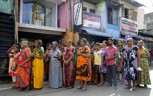 Sri Lankans pray during a three minute nationwide silence observe to pay homage to the victims of Easter Sunday's blasts outside  St. Anthony's Shrine in Colombo, Sri Lanka, Tuesday, April 23, 2019. A state of emergency has taken effect giving the Sri Lankan military war-time powers not used since civil war ended in 2009. Police arrested 40 suspects, including the driver of a van allegedly used by suicide bombers involved in deadly Easter bombings.