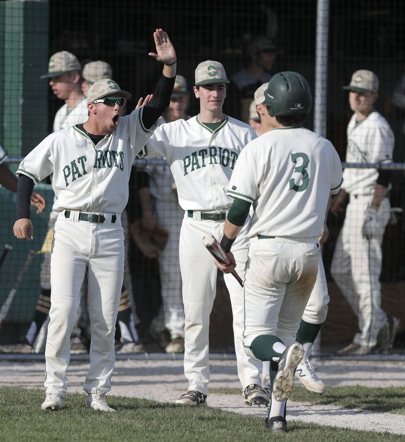 Stevenson's Michael D'Angelo gets high-fives after scoring during their game against Mundelein Tuesday at Stevenson High School in Lincolnshire.