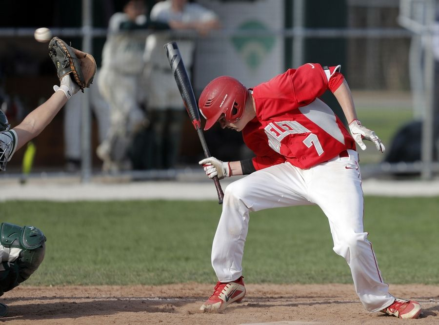 Mundelein's Mason Schultz ducks to avoid an inside pitch during their game Tuesday at Stevenson High School in Lincolnshire.
