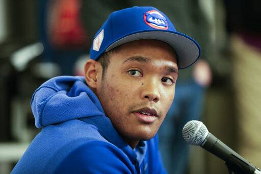 FILE - In this Friday, Feb. 15, 2019, file photo, Chicago Cubs shortstop Addison Russell speaks at a news conference after a spring training baseball workout in Mesa, Ariz. Russell is joining Triple-A Iowa to prepare for his return from a 40-game suspension for violating Major League Baseball's domestic violence policy. Russell is expected to play when Iowa begins a nine-game homestand Wednesday, April 24 against Nashville.