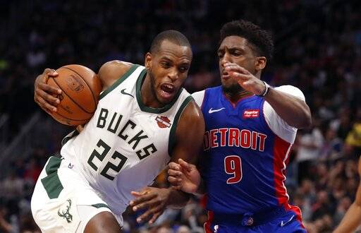 Milwaukee Bucks forward Khris Middleton (22) is defended by Detroit Pistons guard Langston Galloway (9) during the first half of Game 4 of a first-round NBA basketball playoff series, Monday, April 22, 2019, in Detroit.