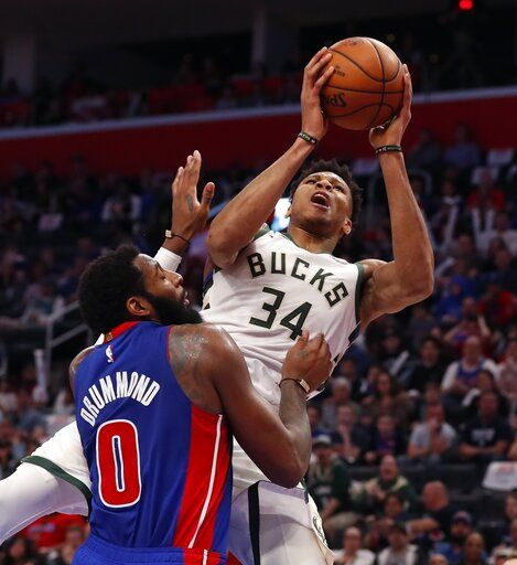 Milwaukee Bucks forward Giannis Antetokounmpo (34) is fouled by Detroit Pistons center Andre Drummond (0) during the first half of Game 4 of a first-round NBA basketball playoff series, Monday, April 22, 2019, in Detroit.