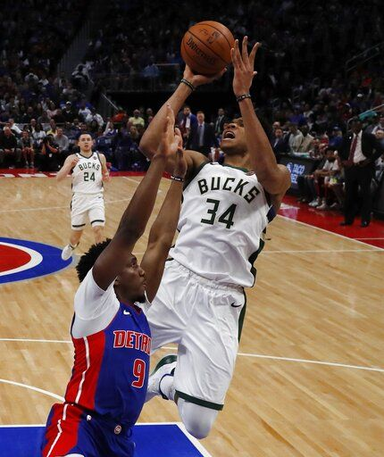Milwaukee Bucks forward Giannis Antetokounmpo (34) shoots as Detroit Pistons guard Langston Galloway (9) defends during the second half of Game 4 of a first-round NBA basketball playoff series, Monday, April 22, 2019, in Detroit.