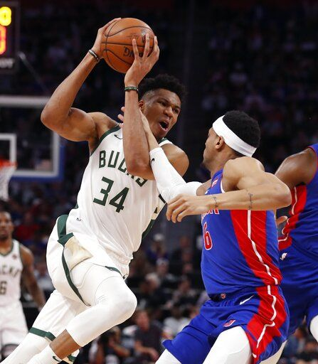 Milwaukee Bucks forward Giannis Antetokounmpo (34) is fouled by Detroit Pistons guard Bruce Brown (6) during the first half of Game 4 of a first-round NBA basketball playoff series, Monday, April 22, 2019, in Detroit.
