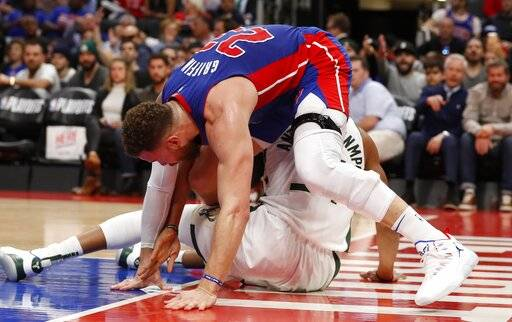 Detroit Pistons forward Blake Griffin (23) and Milwaukee Bucks forward Giannis Antetokounmpo become entangled during the first half of Game 4 of a first-round NBA basketball playoff series, Monday, April 22, 2019, in Detroit.