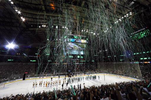 The Nashville Predators and Dallas Stars line up to congratulate each other after the Stars won 2-1 in overtime in Game 6 of an NHL hockey first-round playoff series in Dallas, Monday, April 22, 2019. (AP Photo/Tony Gutierrez)