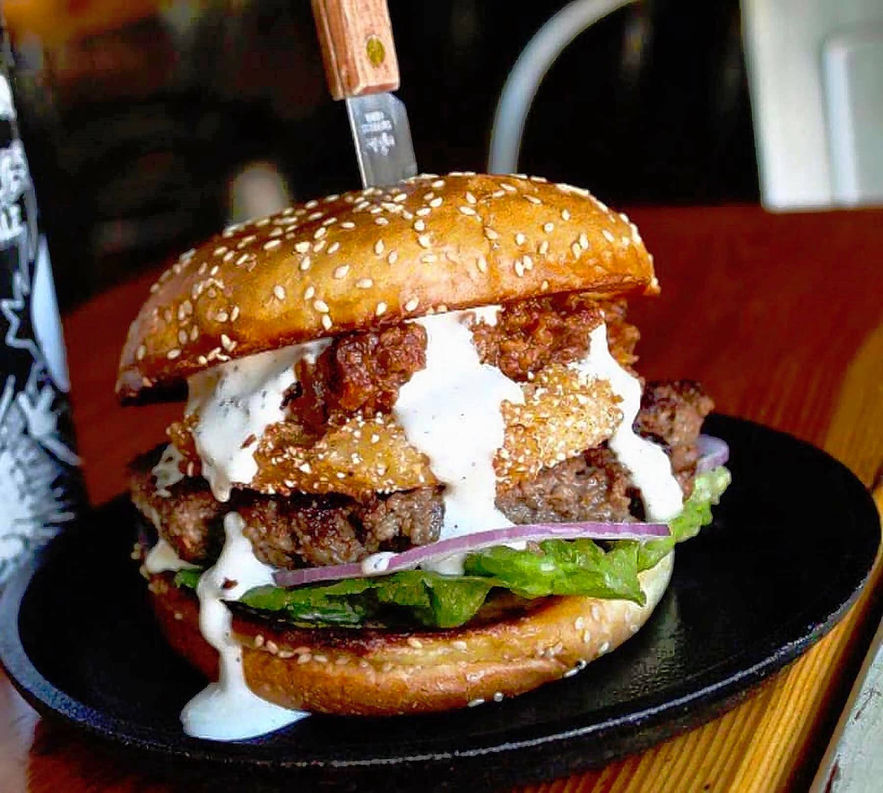Oscar Lee's Barbecue serves up burgers such as the half-pound brisket patty topped with a fried green tomato, bacon jam and house ranch dressing on a sesame brioche bun.