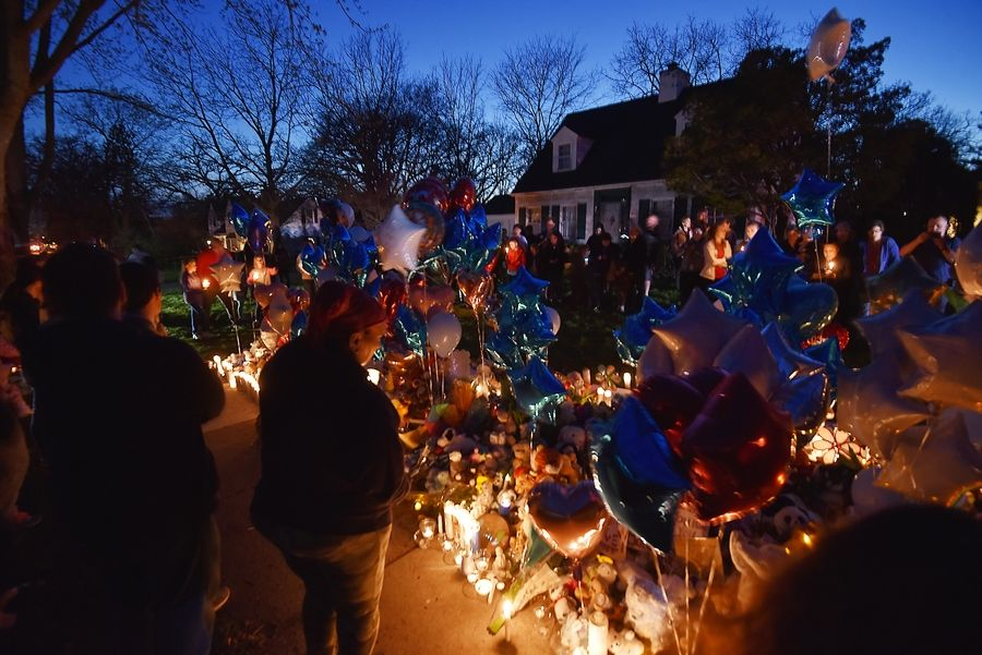"A Wednesday night vigil in Crystal Lake drew hundreds looking for an outlet for their sorrow over the murder of 5-year-old Andrew ""AJ"" Freund."