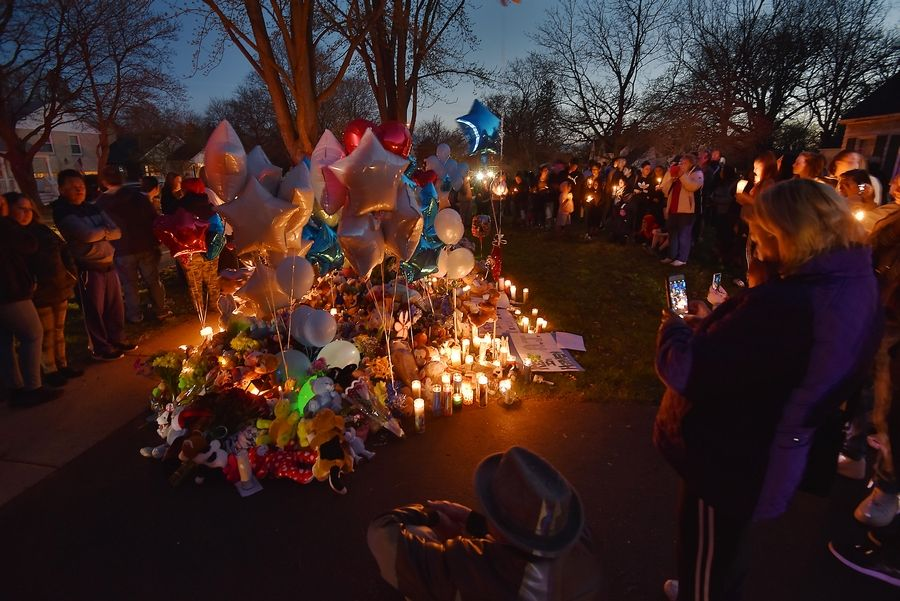 "The memorial of balloons, stuffed animals, signs and other items for Andrew ""AJ"" Freund grew Wednesday night."