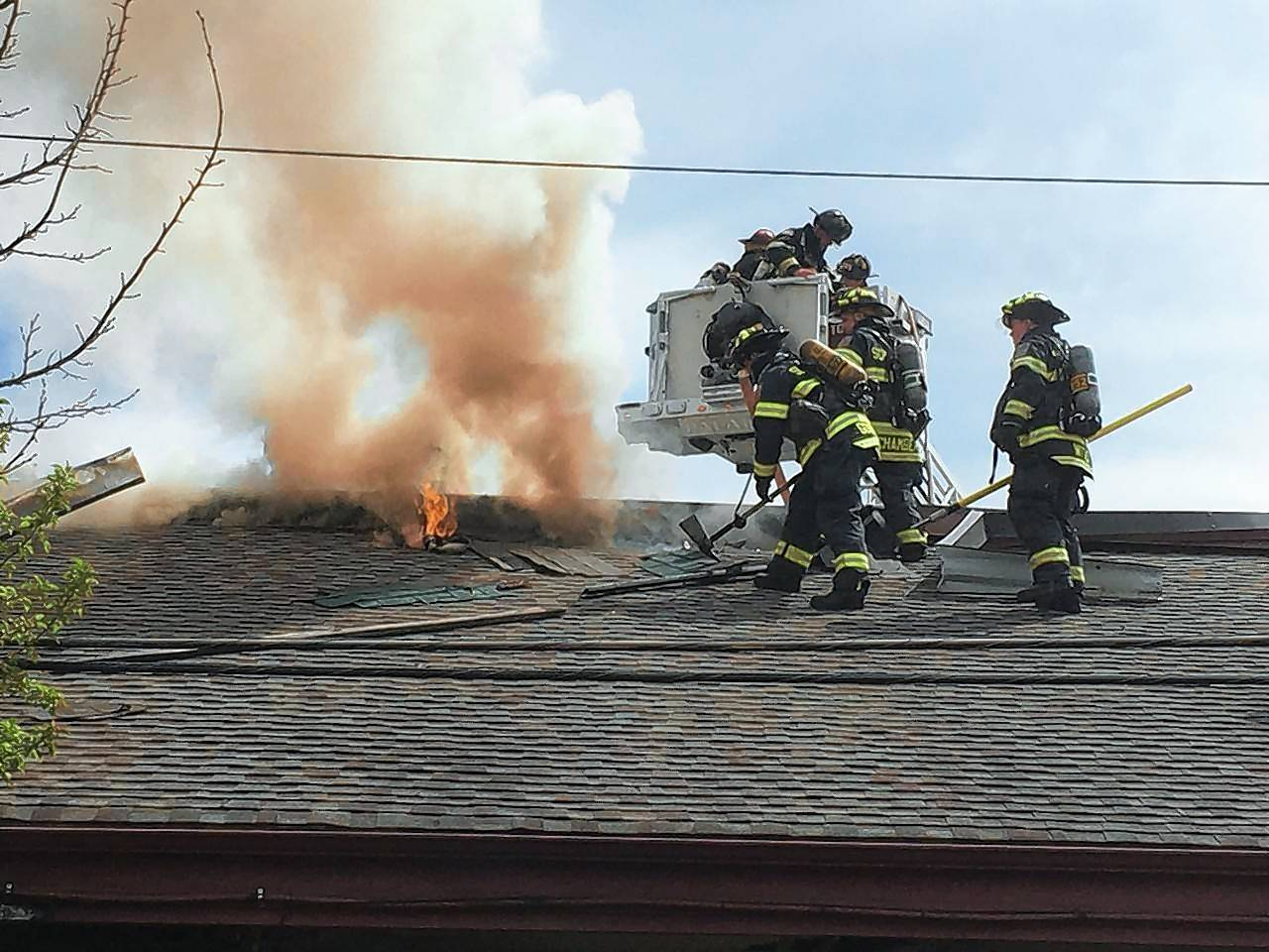 Firefighters battled a blaze from the roof of Egg'lectic Cafe Wednesday in Rolling Meadows. The fire caused an estimated $100,000 in damage to the restaurant.
