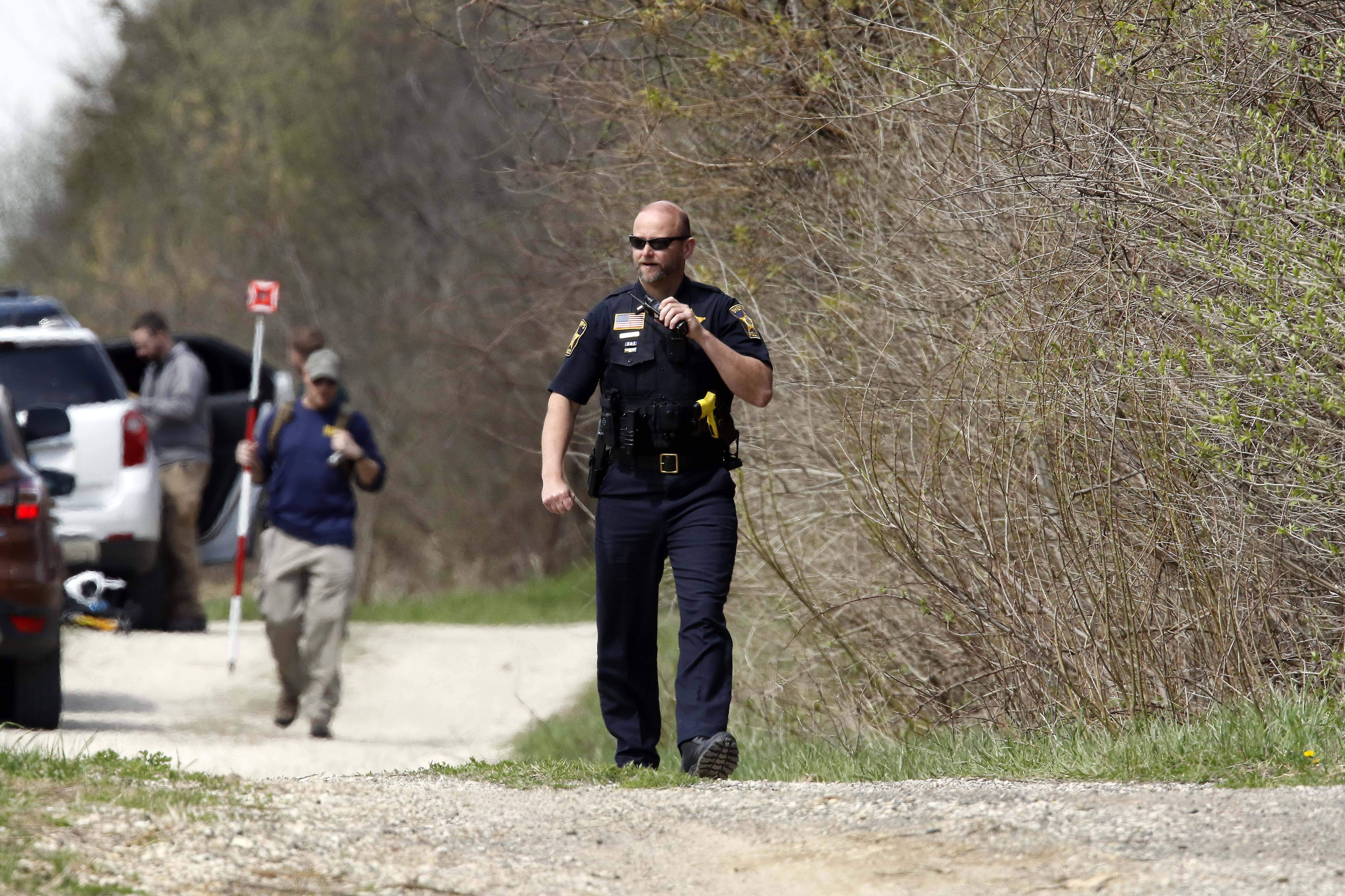 "McHenry County sheriff's officers and other law enforcement search near Route 176 and Dean Street south of Woodstock Wednesday for clues to the disappearance of 5-year-old Andrew ""AJ"" Freund."