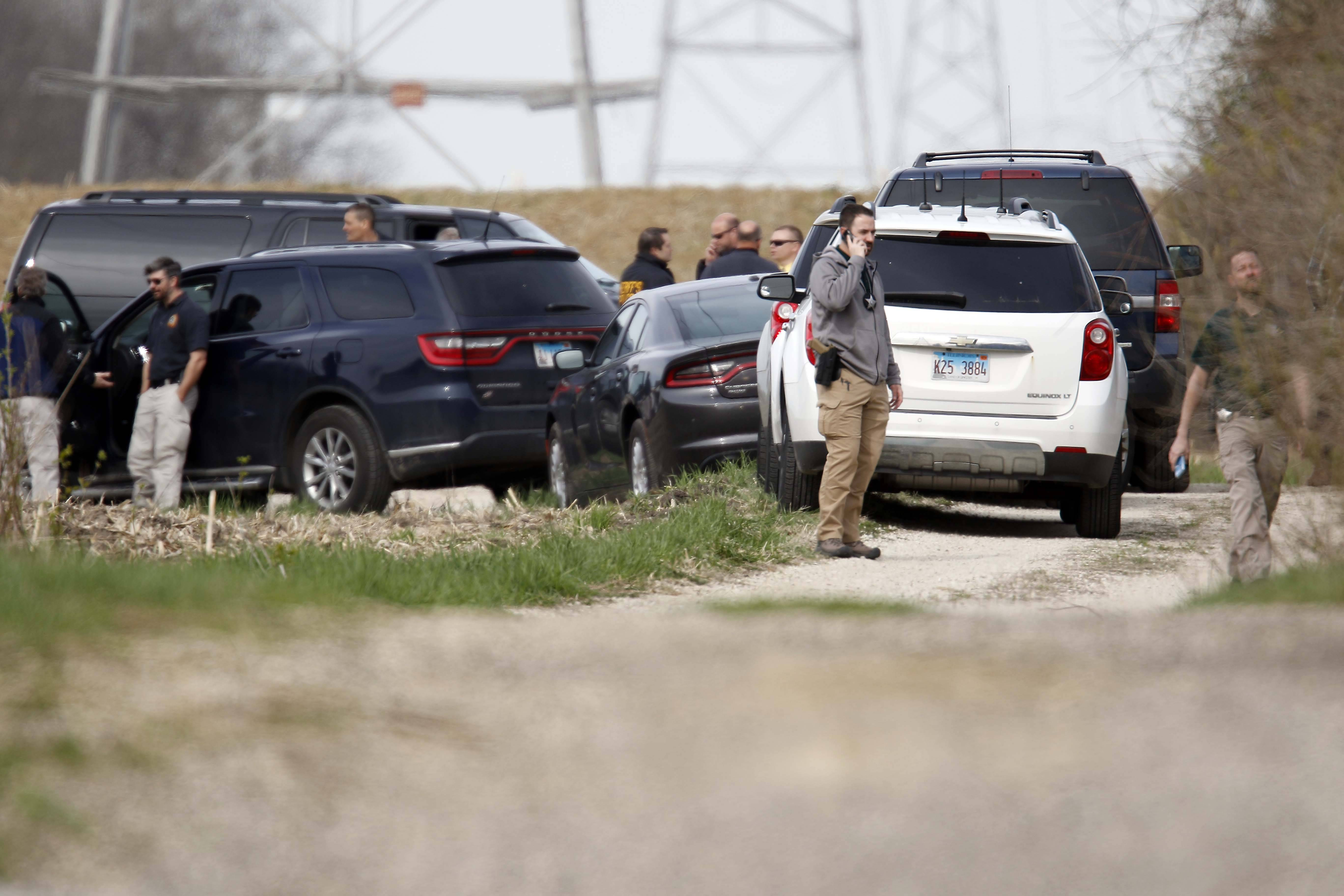 "McHenry County sheriff's officers search near Route 176 and Dean Street south of Woodstock Wednesday for clues to the disappearance of 5-year-old Andrew ""AJ"" Freund."