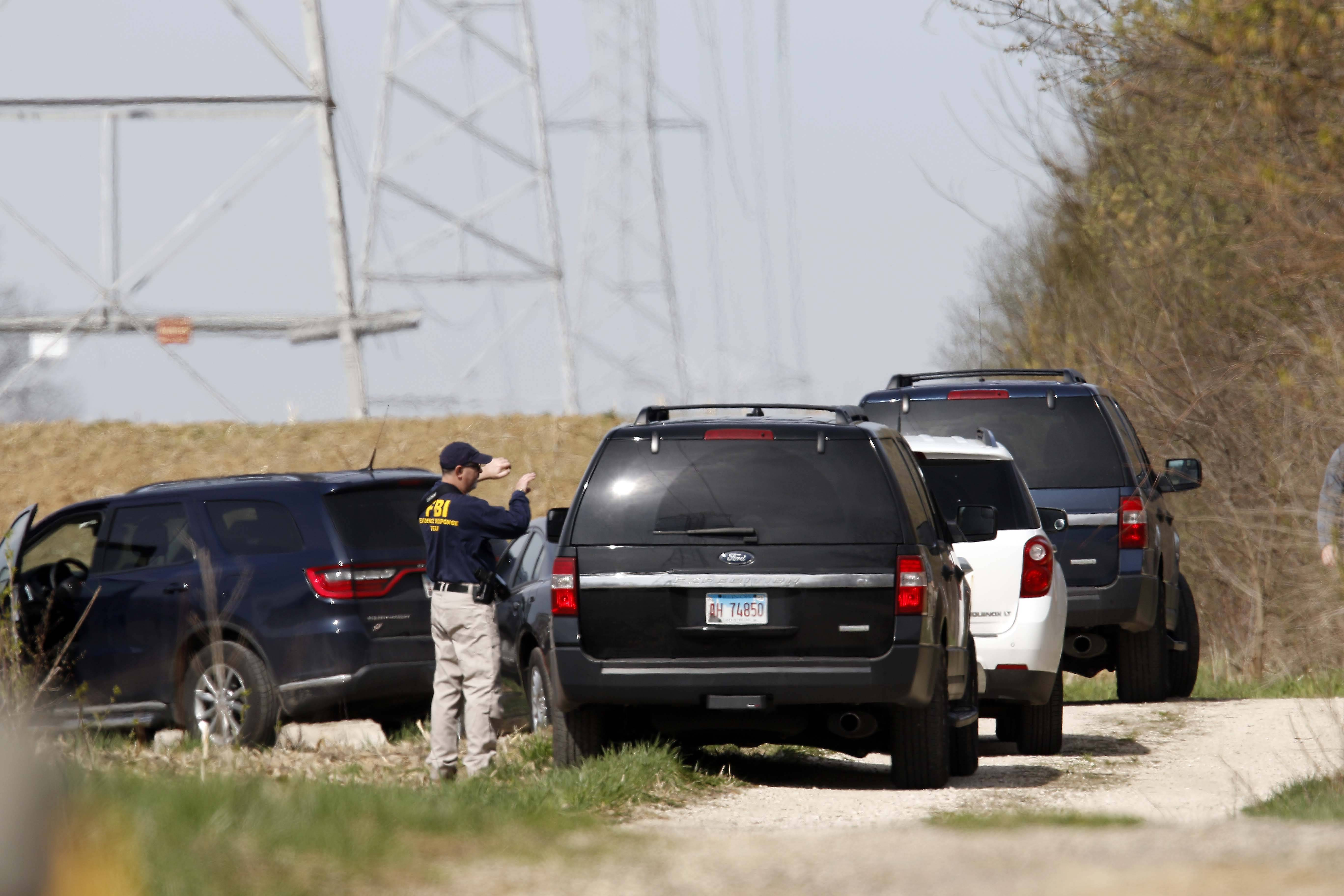 "McHenry County sheriff's officers search for 5-year-old Andrew ""AJ"" Freund near Route 176 and Dean Street south of Woodstock on Wednesday."