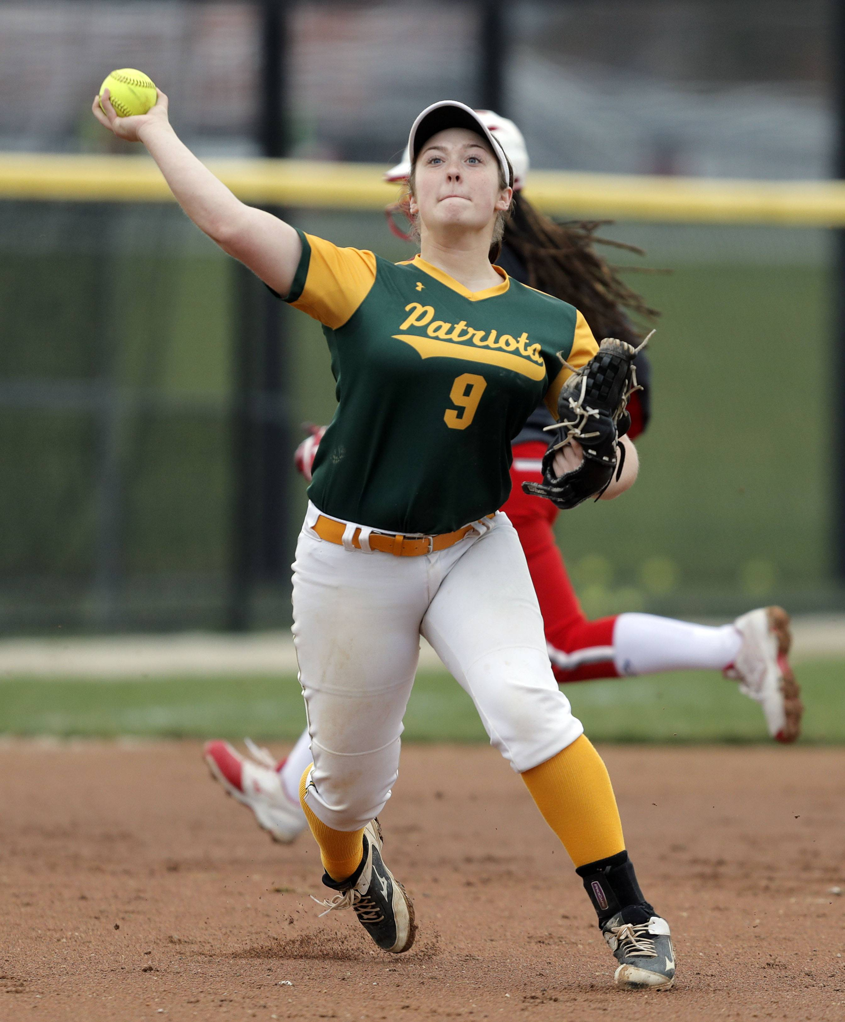 Stevenson's Maggie O'Brien throws to first during their game Wednesday at Grant High School in Fox Lake.