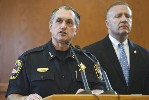 "Crystal Lake, Ill., Police Chief James Black, left, and FBI Special Agent Jeffrey Sallet announce during a press conference Wednesday that the parents of Andrew ""AJ"" Freund are responsible for his death, Wednesday, April 24, 2019. (Paul Valade/Daily Herald via AP)"