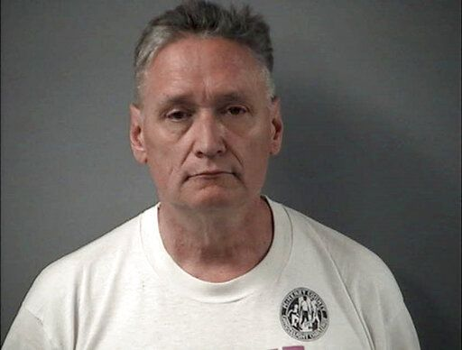 "In this April 24, 2019 is a booking photo provided by the Crystal Lake Police Department of Andrew Freund Sr, who along with his wife Joann Cunningham, have been charged with murder and other charges in the death of their missing son Andrew ""AJ"" Freund. Authorities say they have found what they believe is the body of the 5-year-old boy who went missing last week. Crystal Lake police Chief James Black said at a news conference Wednesday that police dug up what they believe is Freund's body in a field and that it was wrapped in plastic. (Crystal Lake Police Department via AP)"