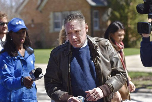 "Andrew Freund Sr., the father of the missing 5-year-old  Andrew ""AJ"" Freund, walks near his home on Dole Avenue in Crystal Lake, Ill. on Friday, April 19, 2019 as members of the media try to speak with him. Police are investigating the boy's disappearance and are focusing their attention on the boy's home. (John Starks/Daily Herald via AP)"