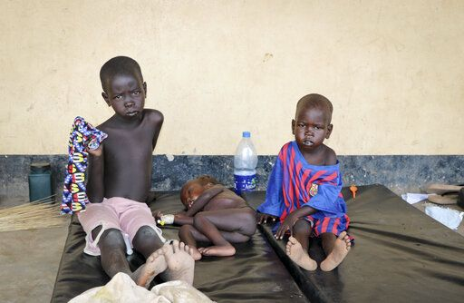 In this photo taken Wednesday, April 17, 2019, three children with measles lie on mats outside the hospital in Kuajok, South Sudan. As South Sudan emerges from a five-year civil war it is grappling with a measles outbreak in which more than 750 cases, including seven deaths, have been reported since January - almost six times the number of cases for all of 2018, according to WHO data.