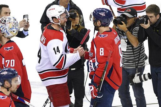 ff780ddf5 Carolina Hurricanes right wing Justin Williams (14) shakes hands with Washington  Capitals left wing