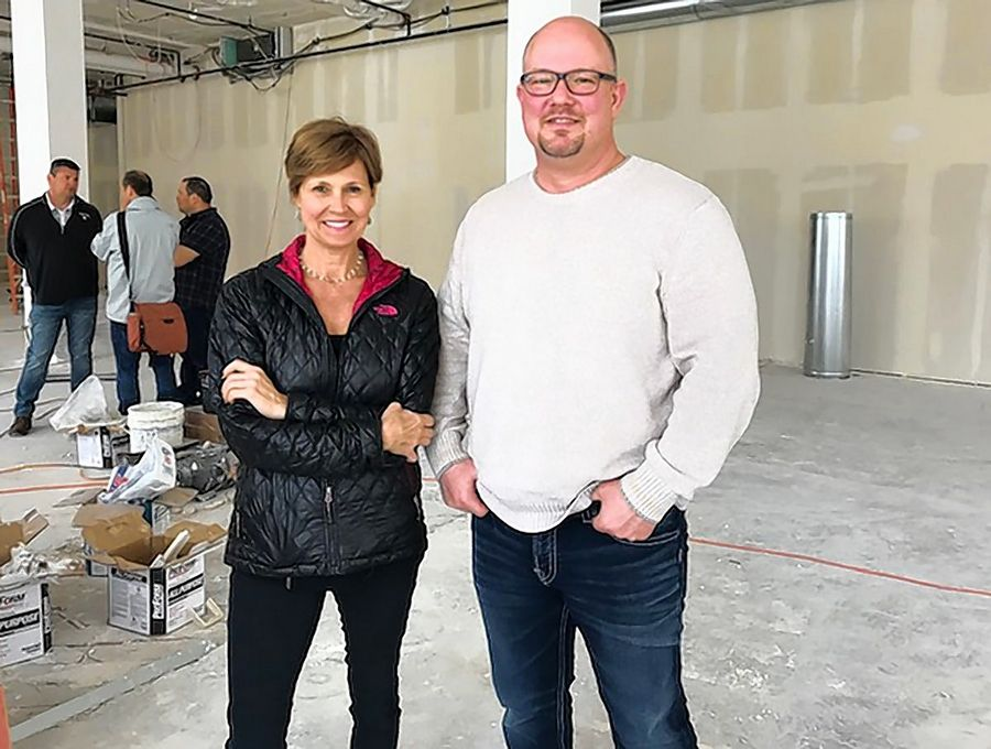 Restaurant owner Amy Morton, left, and Tim Rater, president and chief executive officer of the Aurora Civic Center Authority, in the space in the John C. Dunham Aurora Arts Center where Morton will open a restaurant. Rater is also president and CEO of the Paramount Theater, which uses part of the building.