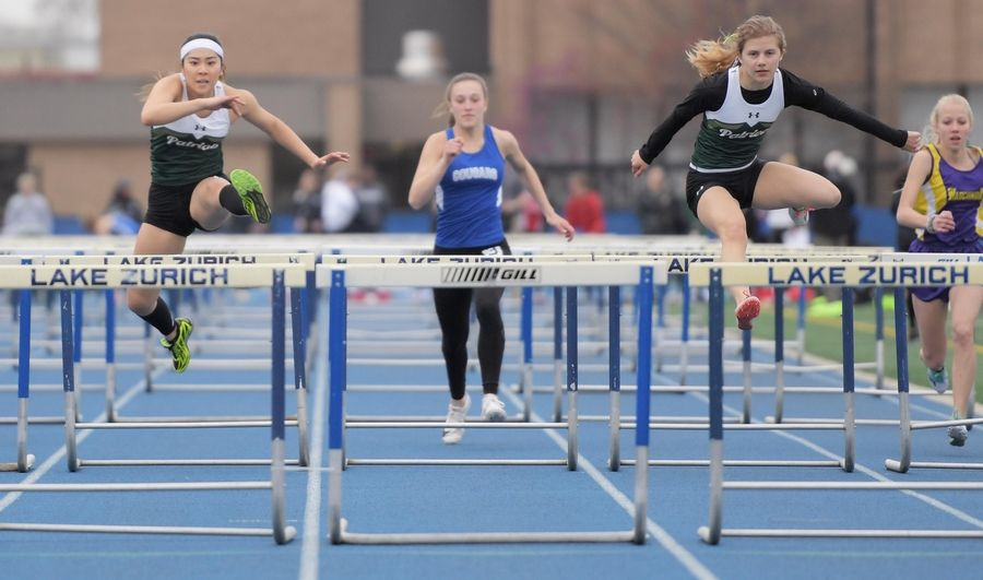 Stevenson's Mia Mikolajczak, right, leads all competitors including teammate Miffy Tani, left, to the finish of the 100-meter hurdles at the Lake County girls track meet in Lake Zurich Thursday.