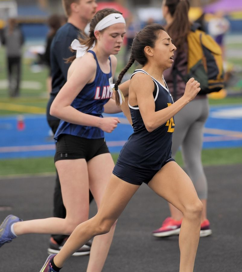 Round Lake's Fatima Giron on her way to a win in the 3,200-meter run at the Lake County girls track meet in Lake Zurich Thursday.