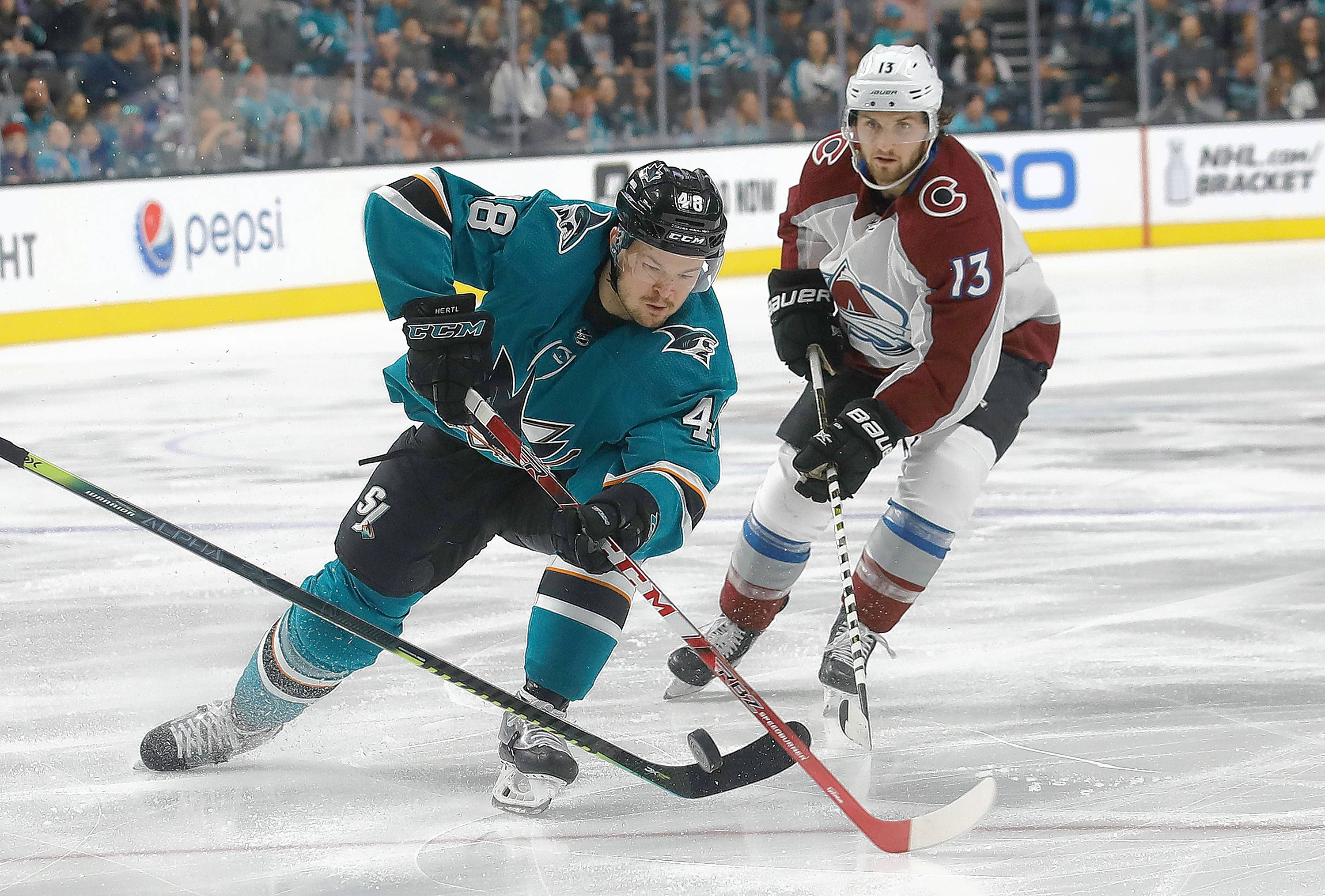 Sharks center Tomas Hertl skates in front of Colorado Avalanche center Alexander Kerfoot during a game April 6 in San Jose, Calif. The Sharks and Avs are facing off again in the second round of NHL playoffs, starting with Friday's game in San Jose.