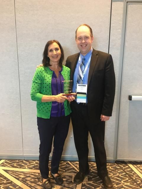 St. Thomas of Villanova Principal Mary Brinkman accepted the 'Grace Under Pressure' Award from Archdiocese of Chicago Superintendent of Schools, Jim Rigg.