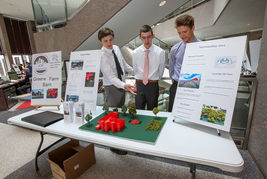Tyler DeNeve, from left, Aaron Benson and Paul Stys, all Naperville Central High School seniors, won best overall concept for their idea to turn the Greene Farm barn and property into a rental space for events and community gardens.
