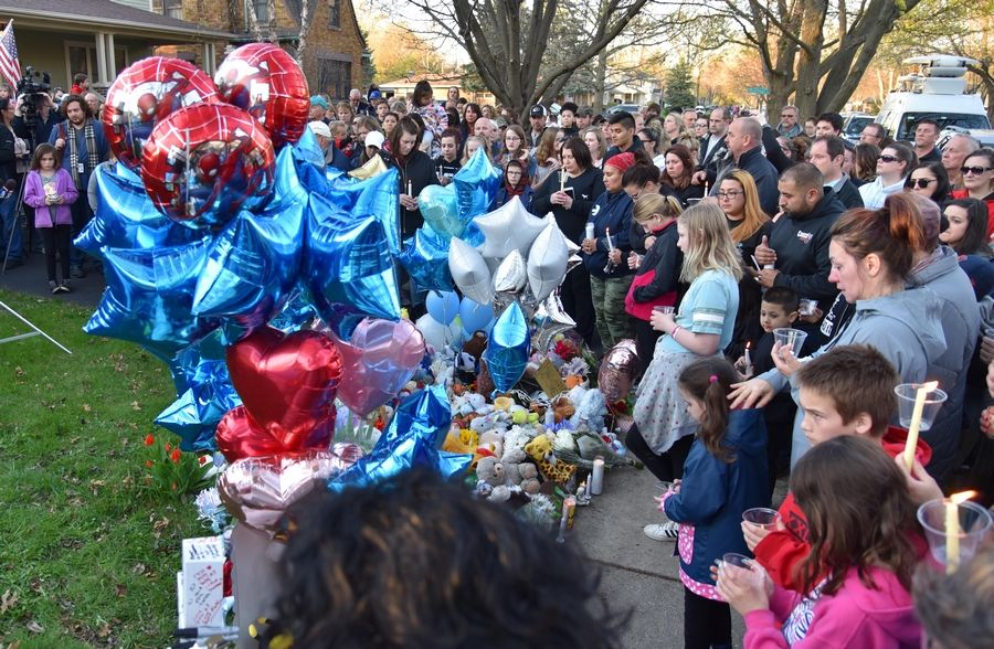 "Hundreds of people turned out for Wednesday night's vigil in Crystal Lake in memory of 5-year-old Andrew ""AJ"" Freund, whose parents have been charged with his murder."