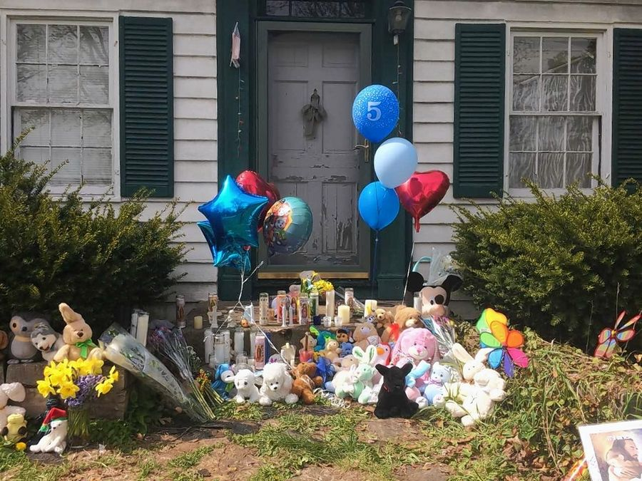 "A curbside memorial to 5-year old Andrew ""AJ"" Freund, whose body was recovered Wednesday, grew overnight to encompass an area at the front of the Crystal Lake home where he had lived."